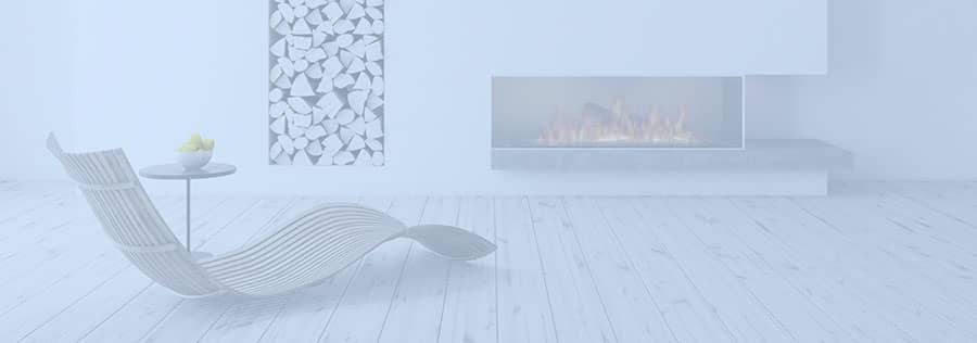 Home in Gibraltar for rent with chair and open fireplace.